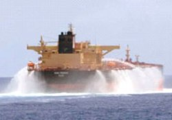 Vessel using water cannon to deter pirates, one of the many non-lethal methods available